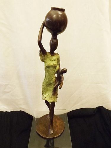"Bronze ""the work of motherhood"" figurine"