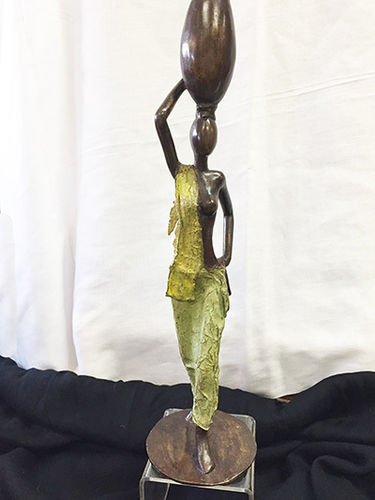 Bronze female with pot figurine